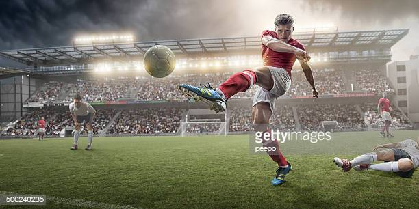 soccer player kicking ball - kicking stock pictures, royalty-free photos & images