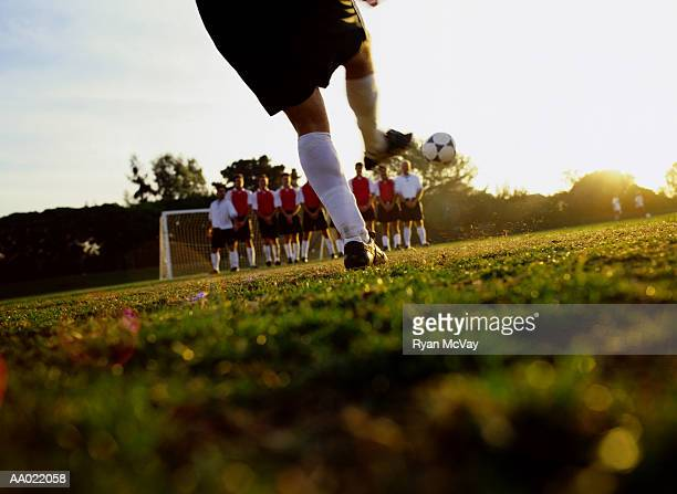 soccer player kicking ball - amateur stock pictures, royalty-free photos & images