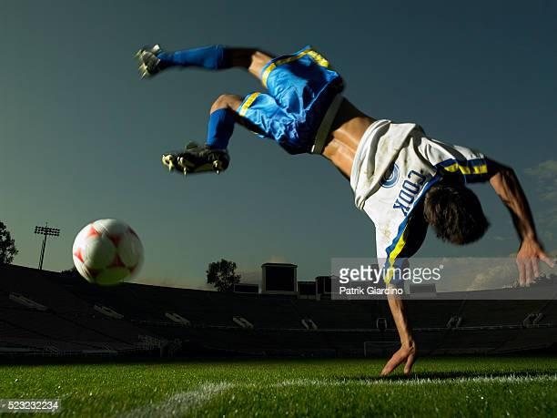 Soccer Player Kicking Goal