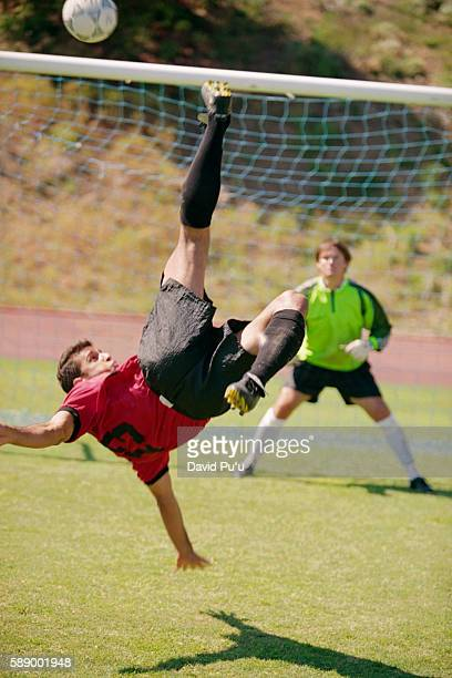 Soccer Player Kicking in Air
