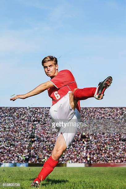 soccer player kicking - shooting at goal stock-fotos und bilder