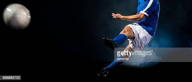 soccer player kicking - sparka bildbanksfoton och bilder