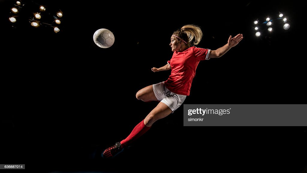 Soccer player kicking : Stock Photo