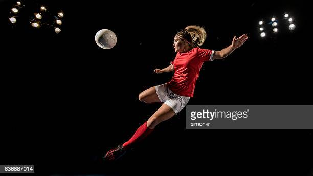 soccer player kicking - football player stock pictures, royalty-free photos & images
