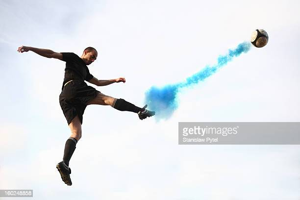 Soccer player kicking smoking ball