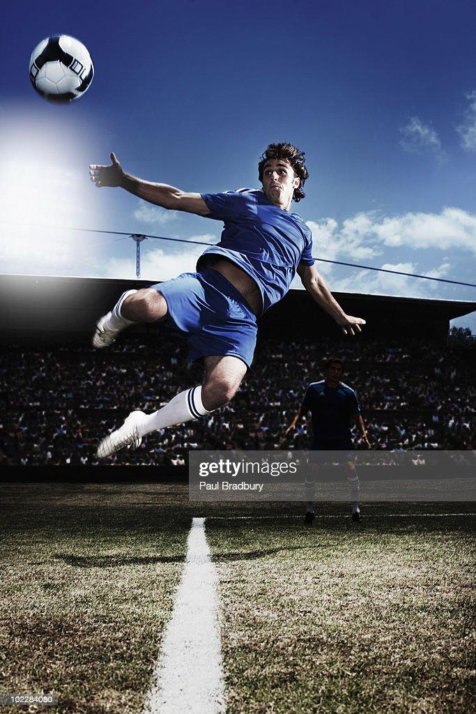 Soccer player kicking soccer ball : Stock Photo