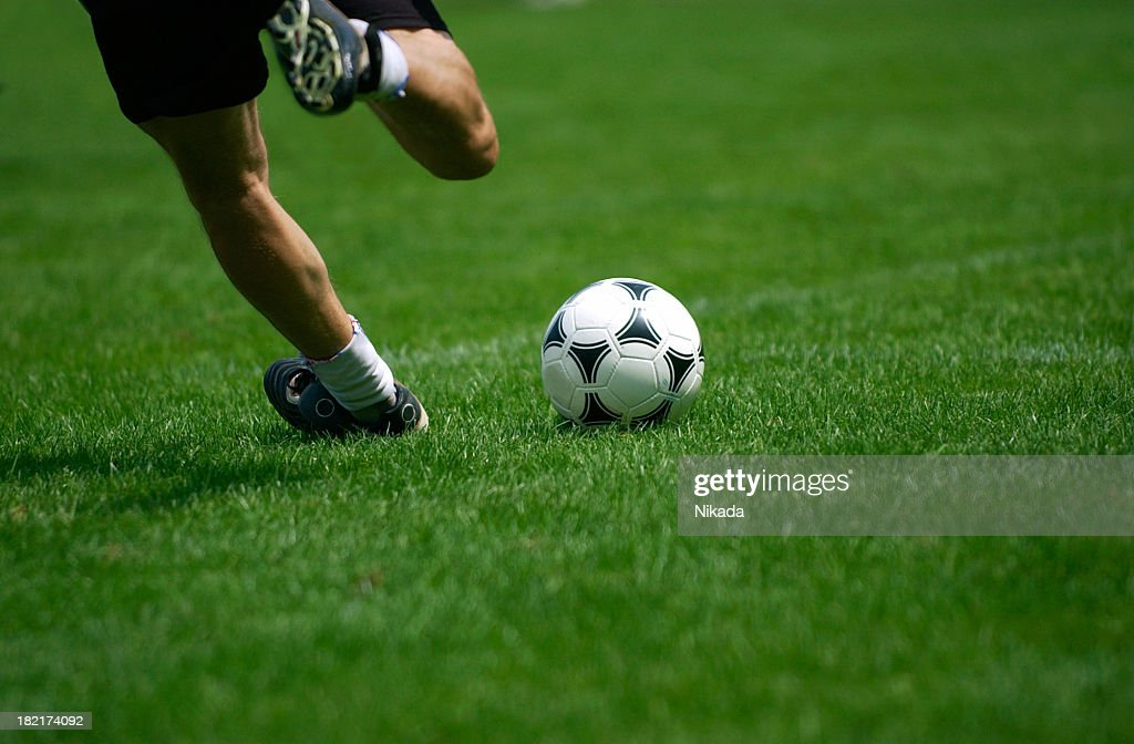 soccer player kicking the ball : Stock Photo