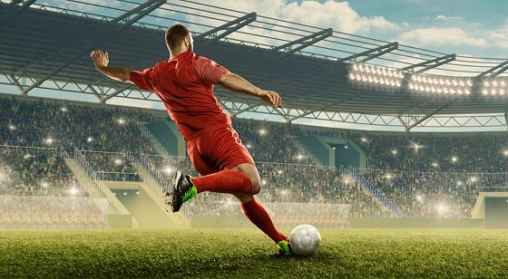 Soccer player kicks a ball 1163749879