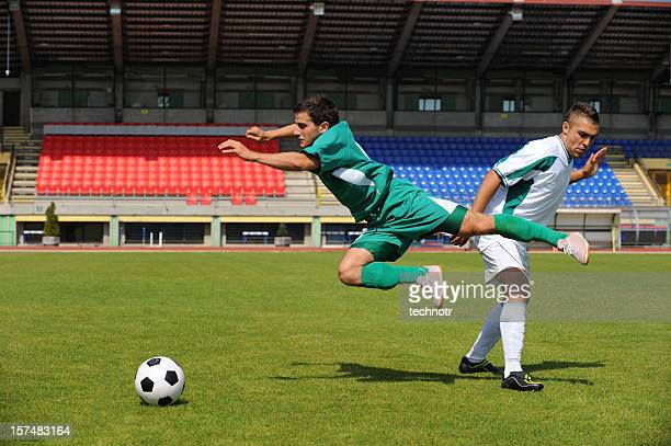 soccer player making foul - foul sports stock pictures, royalty-free photos & images