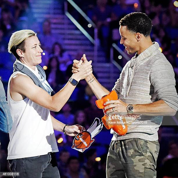 USWNT soccer player Olympian Abby Wambach presents NBA player Stephen Curry with the Best Male Athlete Award during the Nickelodeon Kids' Choice...