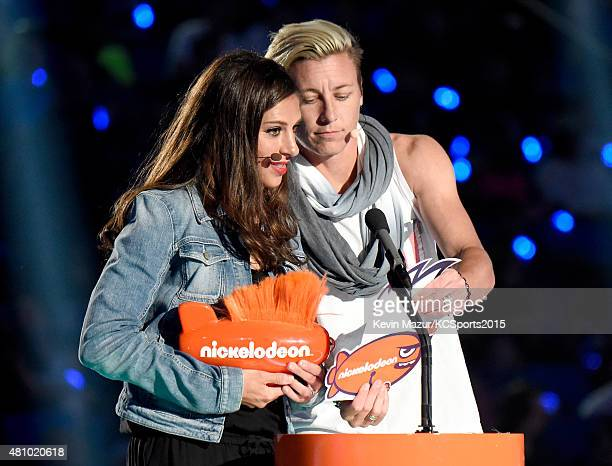 USWNT soccer player Olympian Carli Lloyd accepts the Best Female Athlete Award from USWNT soccer player Olympian Abby Wambach onstage at the...