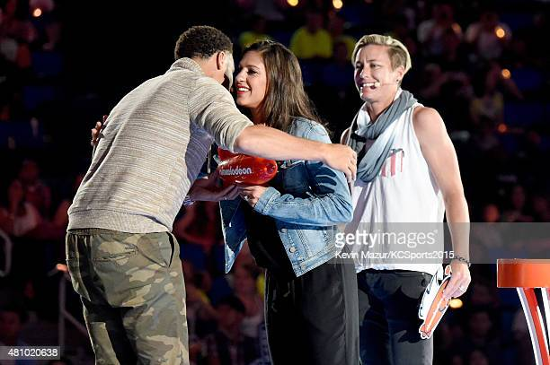 USWNT soccer player Olympian Carli Lloyd accepts the Best Female Athlete Award from NBA player Stephen Curry and USWNT soccer player Olympian Abby...