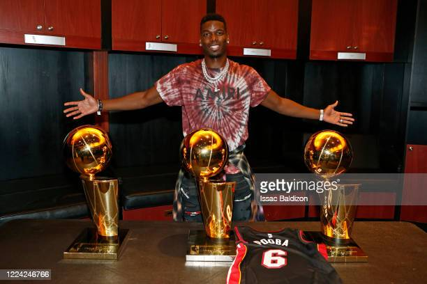 Soccer player Paul Pogba of Manchester United smiles and poses for a photo with the Larry O'Brien Trophy in the Miami Heat locker room after a game...