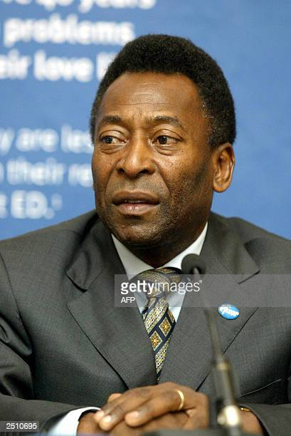Soccer player Pele smiles during a news conference 10 September 2003 in Brussels for the campaign Love Life Again organised by European urology...