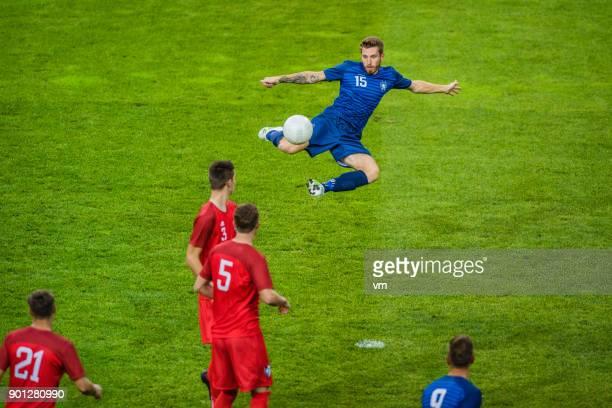 soccer player performing a volley shot - tirare in rete foto e immagini stock