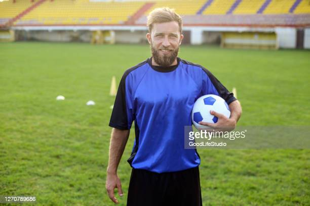 soccer player - football strip stock pictures, royalty-free photos & images