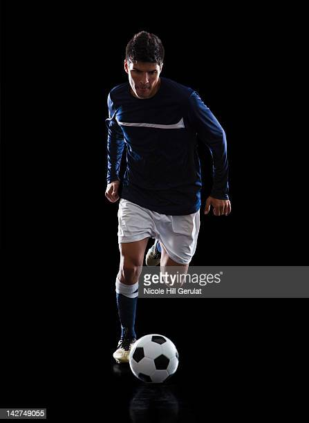 soccer player. - dribbling stock pictures, royalty-free photos & images