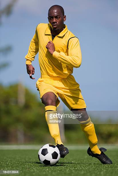 soccer player - fußballstürmer stock-fotos und bilder