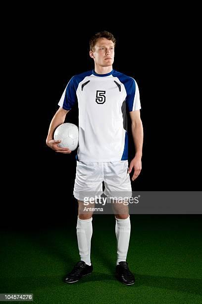 A soccer player, portrait, studio shot