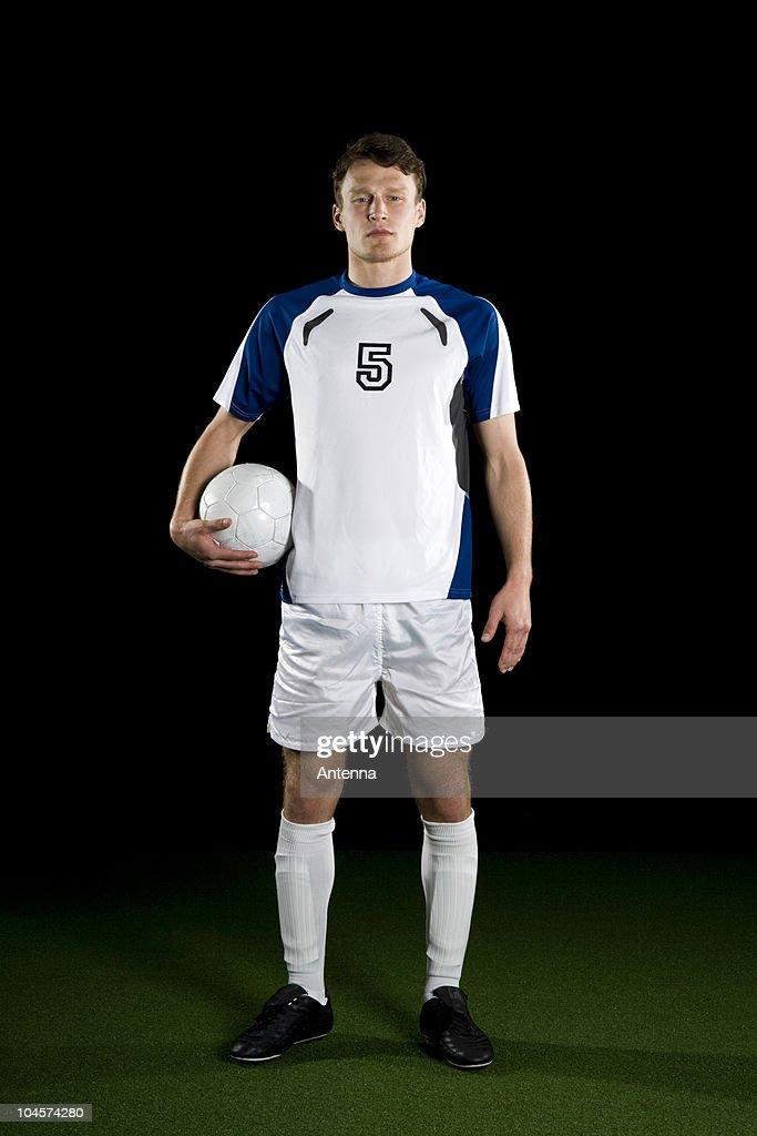 A soccer player, portrait, studio shot : Stock Photo