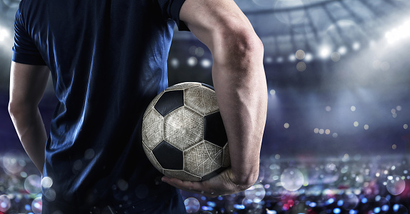 Soccer player ready to play with soccerball at the stadium 1154973244