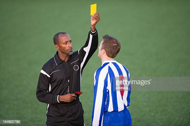 soccer player & referee - yellow card stock pictures, royalty-free photos & images