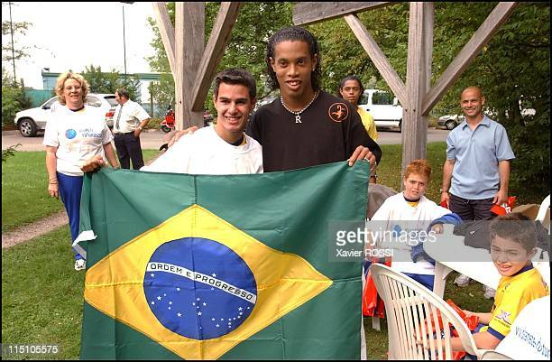 PSG soccer player Ronaldhino receives 15 Brazilian children at the Camp des Loges soccer training camp in Paris France on August 30 2002 The children...