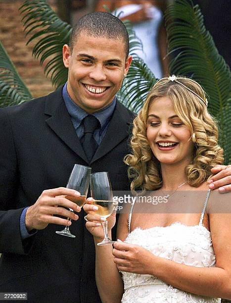 Soccer player Ronaldo is shown with his wife, Milene Domingues during their marriage 24 December 1999 in Rio de Janeiro. Real Madrid's star and his...