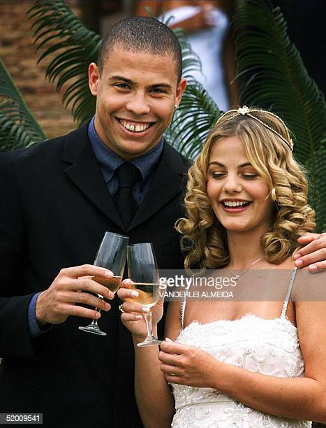Soccer player Ronaldo is shown with his wife, Milene Domingues during their marriage 24 December 1999 in Rio de Janeiro. The couple have announced...
