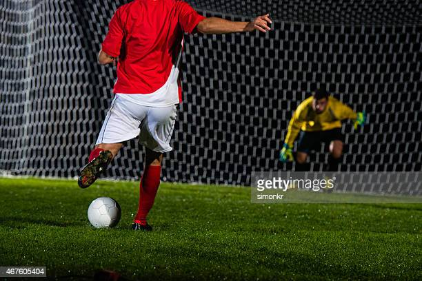 soccer player shooting at goal - shootout stock pictures, royalty-free photos & images