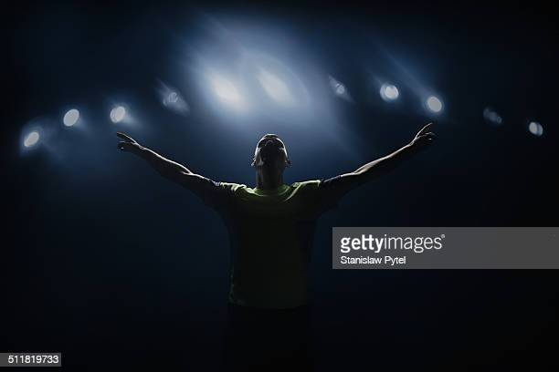 soccer player shouting in stadium, victorious - brama foto e immagini stock