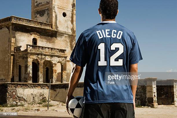 Soccer Player Standing in Old Courtyard