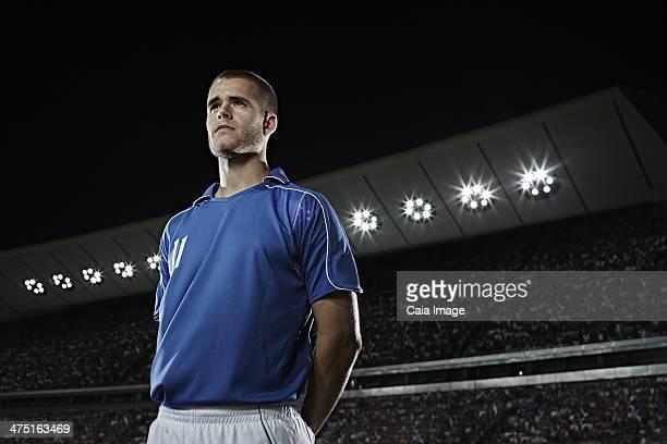 Soccer player standing in stadium