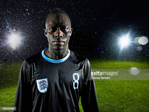soccer player standing on field in rainstorm - hero and not superhero stock pictures, royalty-free photos & images
