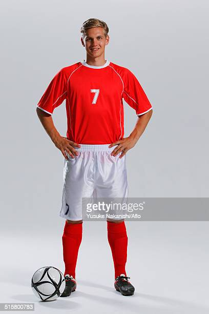 Soccer Player Standing With Ball