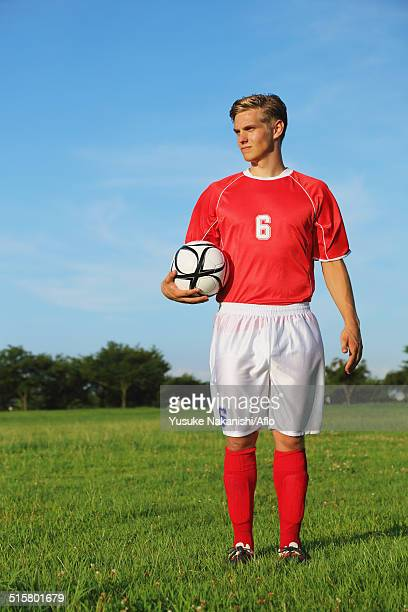 soccer player standing with ball - 自然現象 ストックフォトと画像