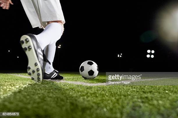 Soccer player starting a corner kick of ball