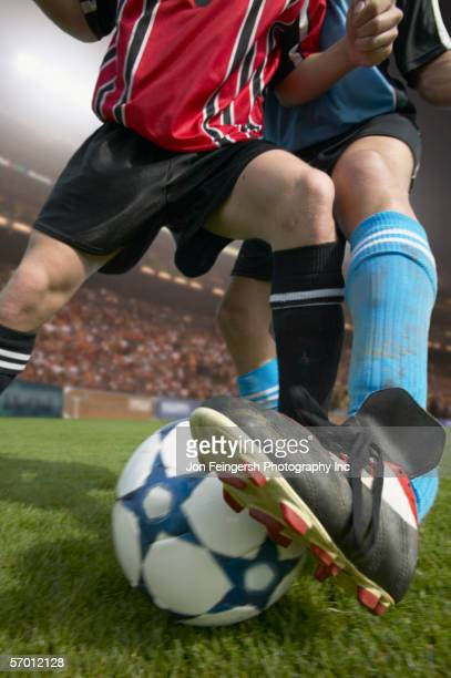 soccer player stealing the ball - arab feet photos et images de collection