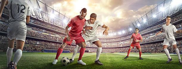 Soccer Player Tackling Ball In Stadium Wall Art