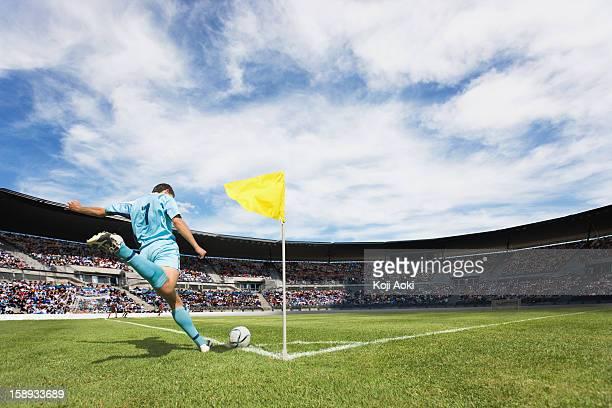 soccer player taking a corner kick - calcio di punizione foto e immagini stock