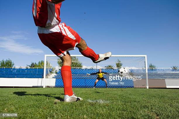 A soccer player taking a penalty shot