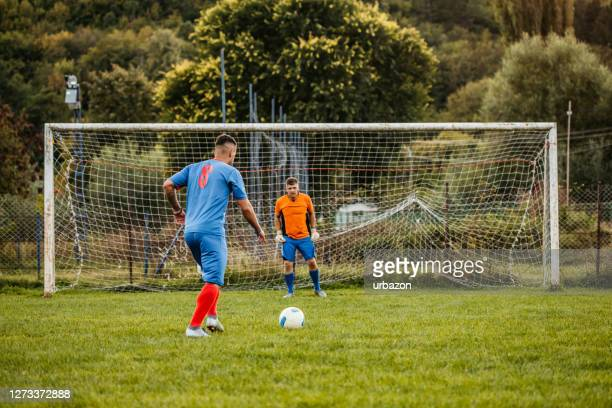 soccer player taking penalty kick - penalty stock pictures, royalty-free photos & images