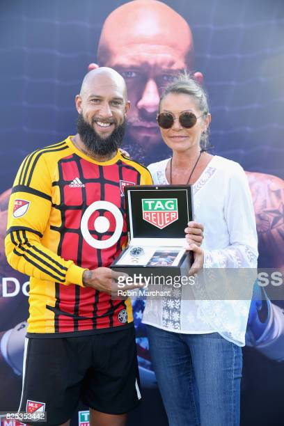 Soccer player Tim Howard and VP Marketing for TAG Heuer Francoise Bezzola attend TAG Heuer Announces New Brand Ambassador on August 1 2017 in Chicago...