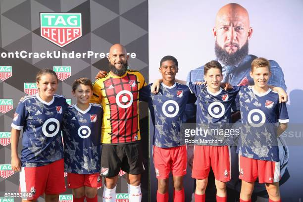 Soccer player Tim Howard with local youth players attends TAG Heuer Announces New Brand Ambassador on August 1 2017 in Chicago Illinois