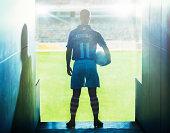 Soccer player walking onto field