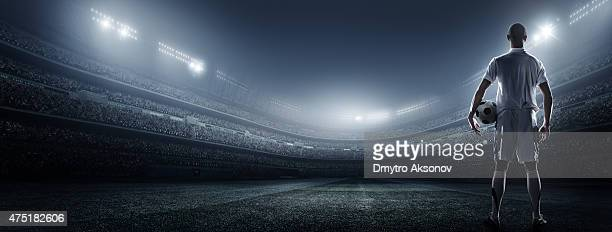 soccer player with ball in stadium - kicking stock pictures, royalty-free photos & images