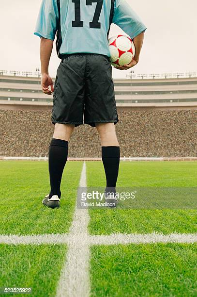 Soccer Player with Ball on the Field