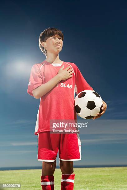 Soccer player with hand over heart