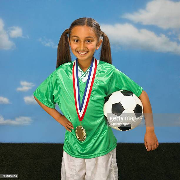 Soccer player with medal