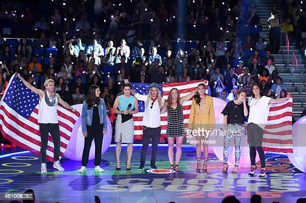 USWNT soccer players Abby Wambach Carli Lloyd Ali Krieger Ashlyn Harris Christie Rampone Christen Press Kelley O'Hara and Hope Solo speak onstage at...